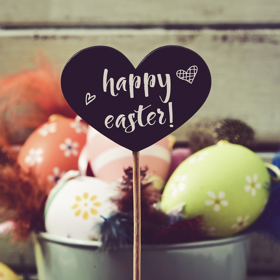 a heart-shaped black chalkboard with the text happy easter writt